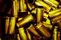 Bullet casings a heap of dirty shell as a background vignette added Stock Images