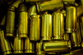 Bullet casings row a of dirty shell as a background vignette added Royalty Free Stock Image