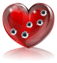 Bullet hole heart concept of a shaped icon with holes for broken or other love or relationships issue Stock Images