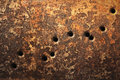 Bullet holes background rusty metallic surfaces perforated with Stock Images