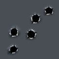 Bullet holes on gray background in vector Royalty Free Stock Image