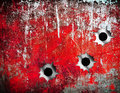Bullet holes in grunge metal plate Stock Photography