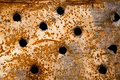 Bullet holes in a plate rusty Royalty Free Stock Photography