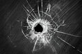 Bullet shot cracked hole on broken window glass Royalty Free Stock Photo