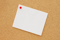 Bulletin board with a blank white greeting card Royalty Free Stock Photo