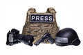 Bulletproof vest, camera, gun and helmet isolated Royalty Free Stock Photo