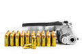 Bullets with the gun isolated on white background Royalty Free Stock Photos
