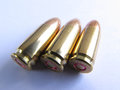 Bullets photo of three for hand gun caliber x mm close up photo taken on june Stock Images