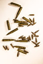 Bullets scattered around as war, crime, criminal, army, military Royalty Free Stock Photo