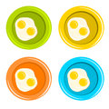 Bulleye eggs in colorful dishes Royalty Free Stock Photo