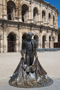 Bullfighter statue in nimes to the nimeno outside the roman arena of france Stock Images