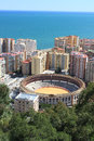 Bullring in malaga spain surrounded by buildings and trees Royalty Free Stock Images