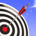 Bulls eye target shows performance goal achieved showing business aim Royalty Free Stock Photos