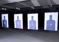 Bullseye targets at gun range lined up Stock Photo