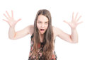 Bully young girl beeing aggressive and shouting with her arm up in the air Royalty Free Stock Photo