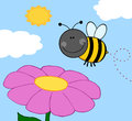 Bumble bee flying over flower smiling Royalty Free Stock Photo