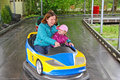 Bumper cars young girl with her mom on car Stock Image