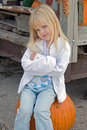 Bumpkin On Pumpkin Stock Images