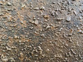 Bumpy dark copper plate texture with oxidation metal Royalty Free Stock Image