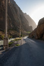 Bumpy mountain road old in canyon in evening light Royalty Free Stock Photos