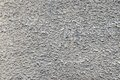 Bumpy texture cement wall of dirty gray color rough an old for empty abstract backgrounds Royalty Free Stock Photo