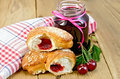 Bun with cherry jam and berries on board Royalty Free Stock Photo