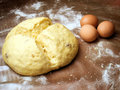 Bun and eggs Stock Photography