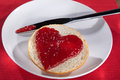 Bun with jam in heart shape Royalty Free Stock Photography