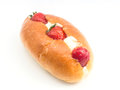Bun with soft cream and strawberry on white background Royalty Free Stock Images