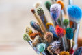 Bunch of artist paintbrushes closeup. Royalty Free Stock Photo