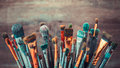 Bunch of artistic paintbrushes. Retro toned.