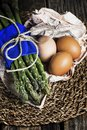 stock image of  Bunch of asparagus with eggs on centerpiece