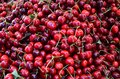 A bunch of berries of cherries at the market.   A large collection of fresh ripe red cherry.  vitamins, healthy food Royalty Free Stock Photo