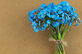 Bunch of blue forget me not flower in front brown paper background Royalty Free Stock Photo