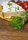 A bunch of chives and a bread with cottage cheese Stock Images