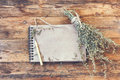 Bunch of dry herb wormwood, notepad for writing Royalty Free Stock Photo