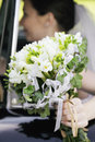 Bunch of flowers in the hand of bride sitting car Royalty Free Stock Photography