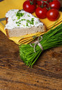 A bunch of fresh chives and a bread with cottage cheese and tomattoes Royalty Free Stock Photo
