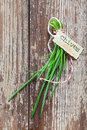 Bunch fresh chives decorative identification label tied string weathered old grungy timber board texture copyspace Royalty Free Stock Photo
