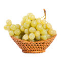 Bunch of grapes in a basket Stock Images