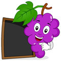 Bunch of Grapes with Blank Blackboard Royalty Free Stock Photo