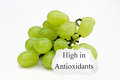 Bunch of grapes a with a sign saying high in antioxidants Royalty Free Stock Image