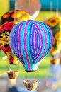 Bunch of hot air balloon toys dangling in the  wind Royalty Free Stock Photo