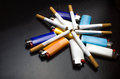 Bunch of lighters and cigarettes Royalty Free Stock Photo