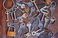 A bunch of old keys  on a wooden table Royalty Free Stock Photo
