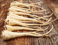 Bunch of parsnip closeup a on a wooden board Royalty Free Stock Image