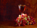 Bunch of red grape and wine glass Royalty Free Stock Photo