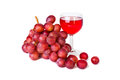 Bunch of red grapes with a glass of wine on white background Stock Photo