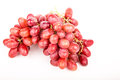 Bunch of red grapes on white a seedless a background Royalty Free Stock Photo