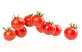 Bunch of red tomatoes isolated on a white background Royalty Free Stock Photos